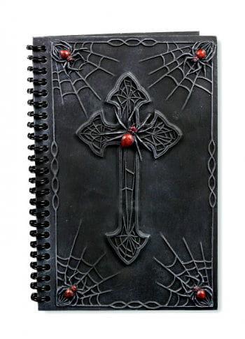 Notizbuch mit Kreuz und Spinnen