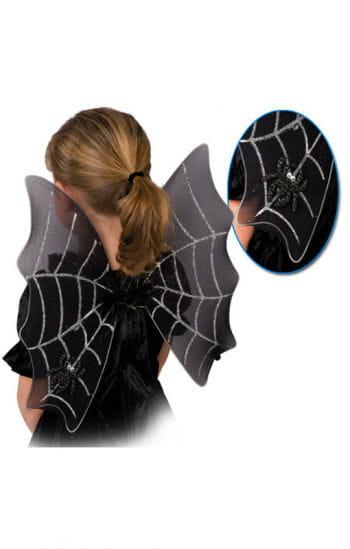 Schwarze Flügel mit Spinnweben
